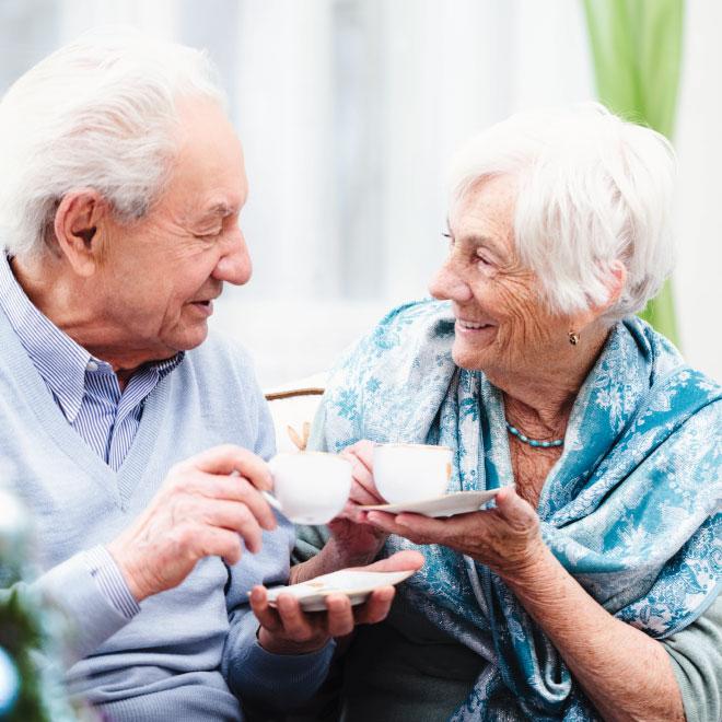 Senior man and woman drinking tea