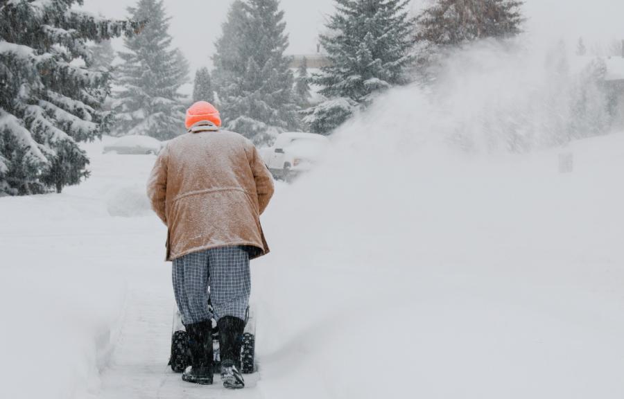 Senior Man Snow blowing