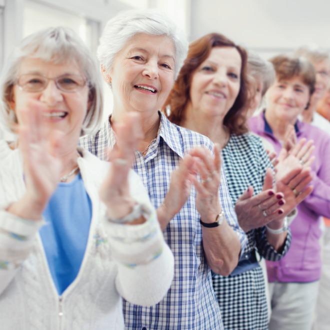 Group of senior women applauding