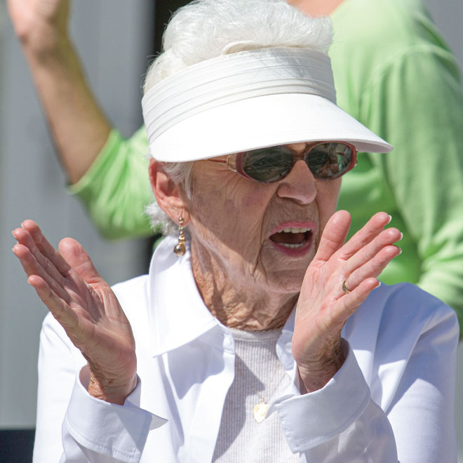 Woman with visor clapping