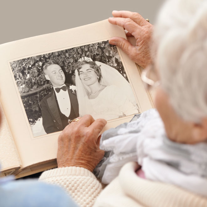 Senior man and woman looking at a photo album