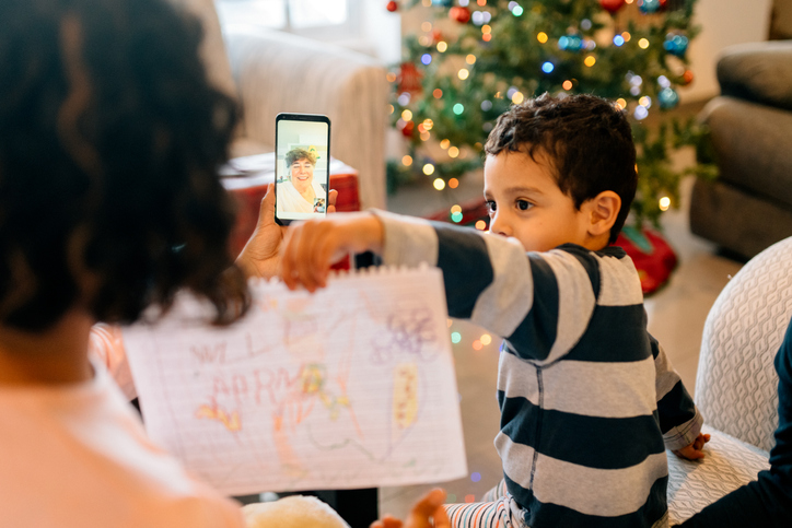 Grandson showing grandmother a drawing on video call