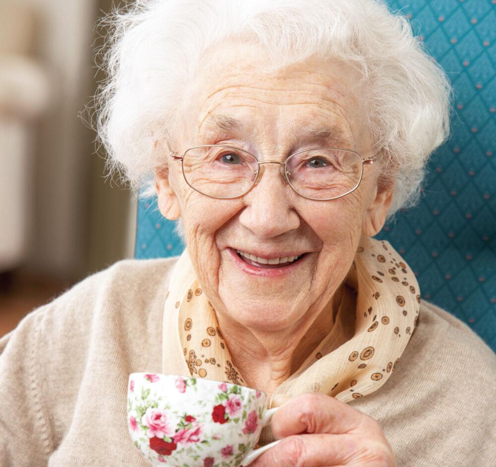 senior woman enjoying a warm cup of tea